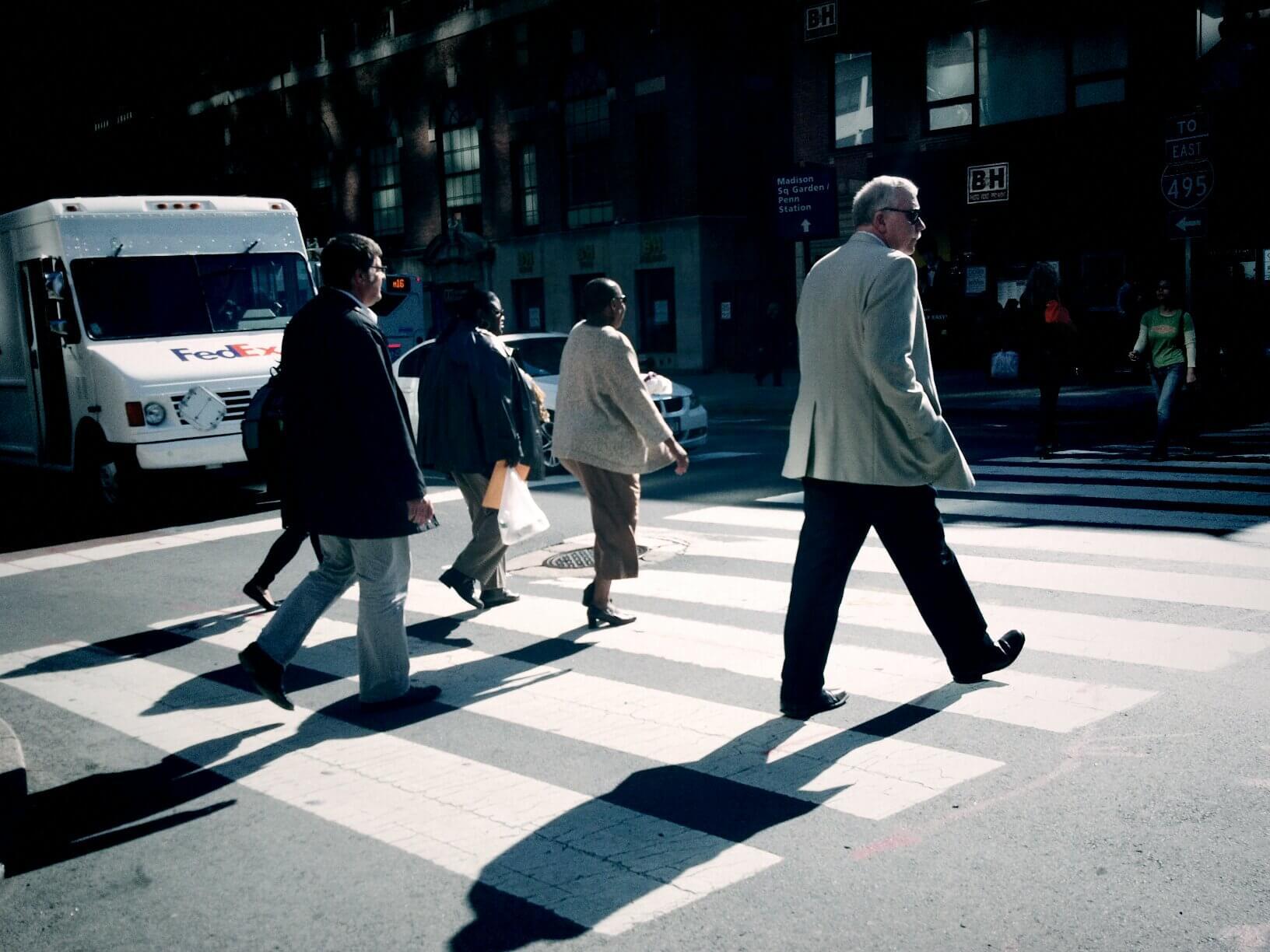 People crossing crosswalk in Manhattan