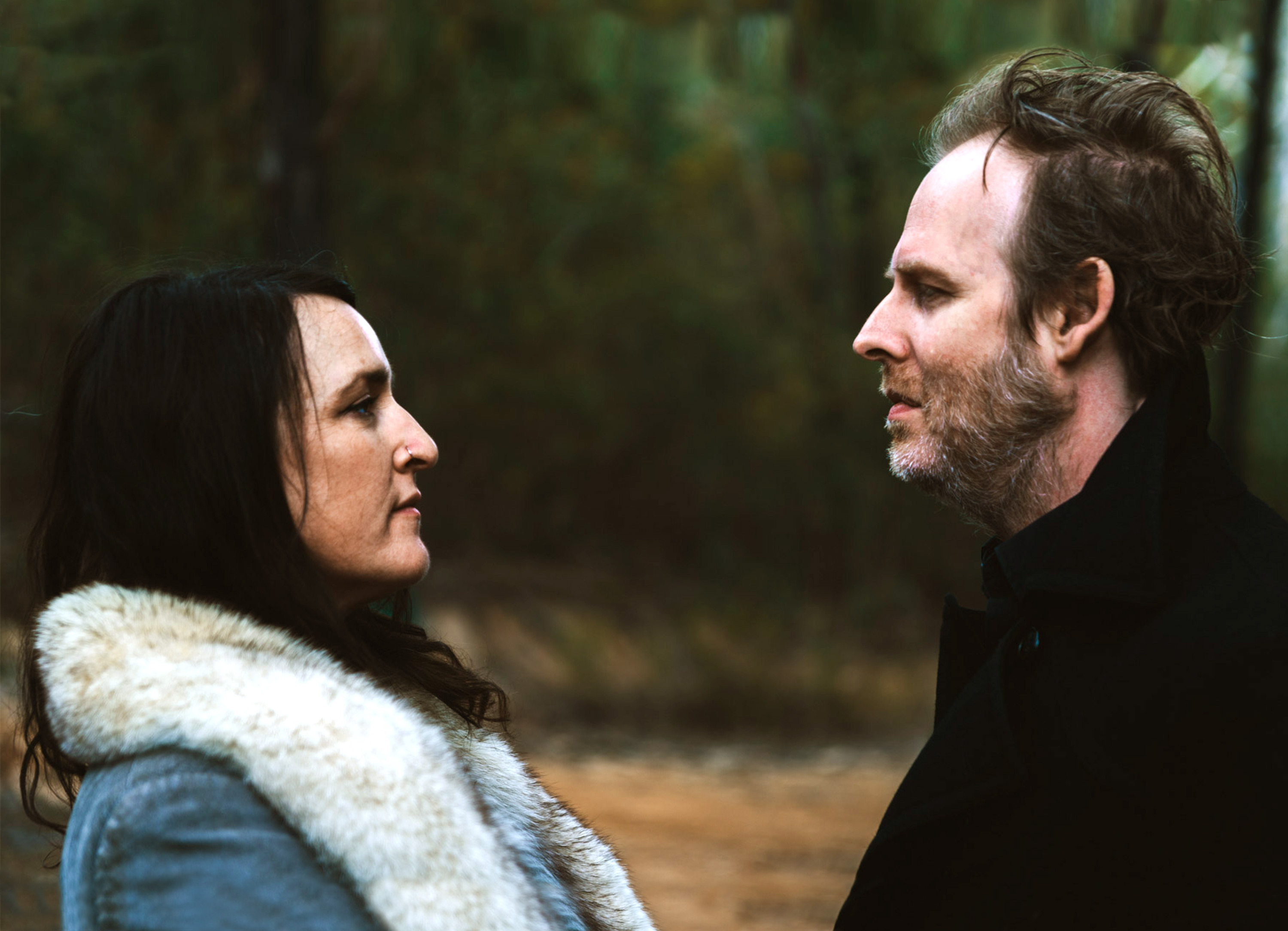 Photo of Katie and Brett looking at each other
