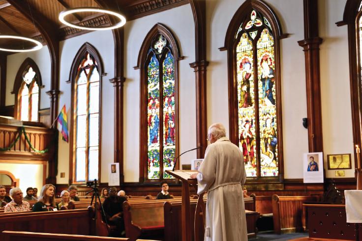 Man preaching to church.