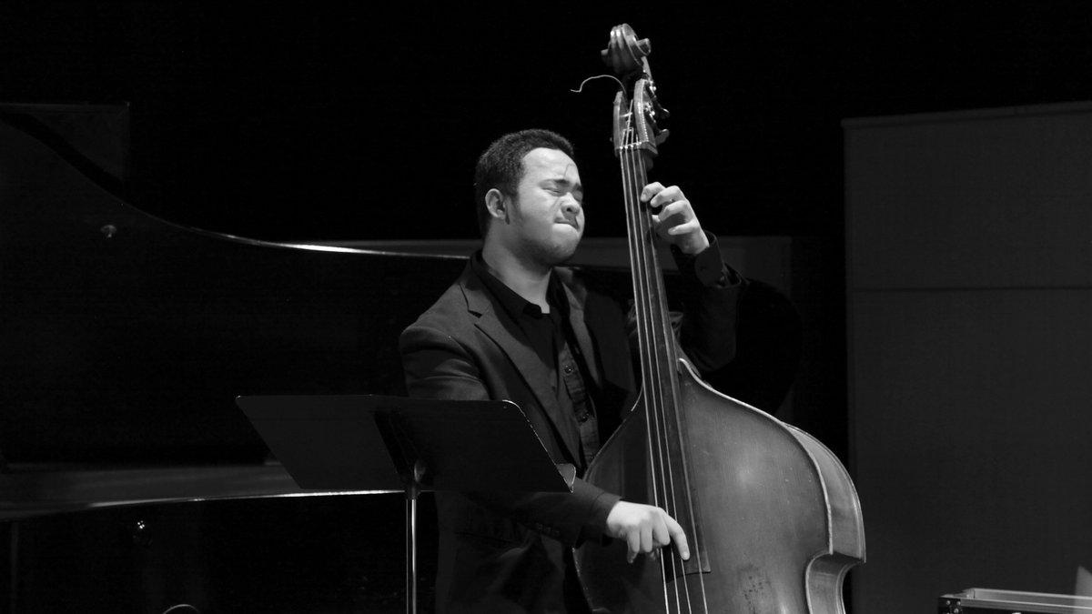 musician plays upright bass