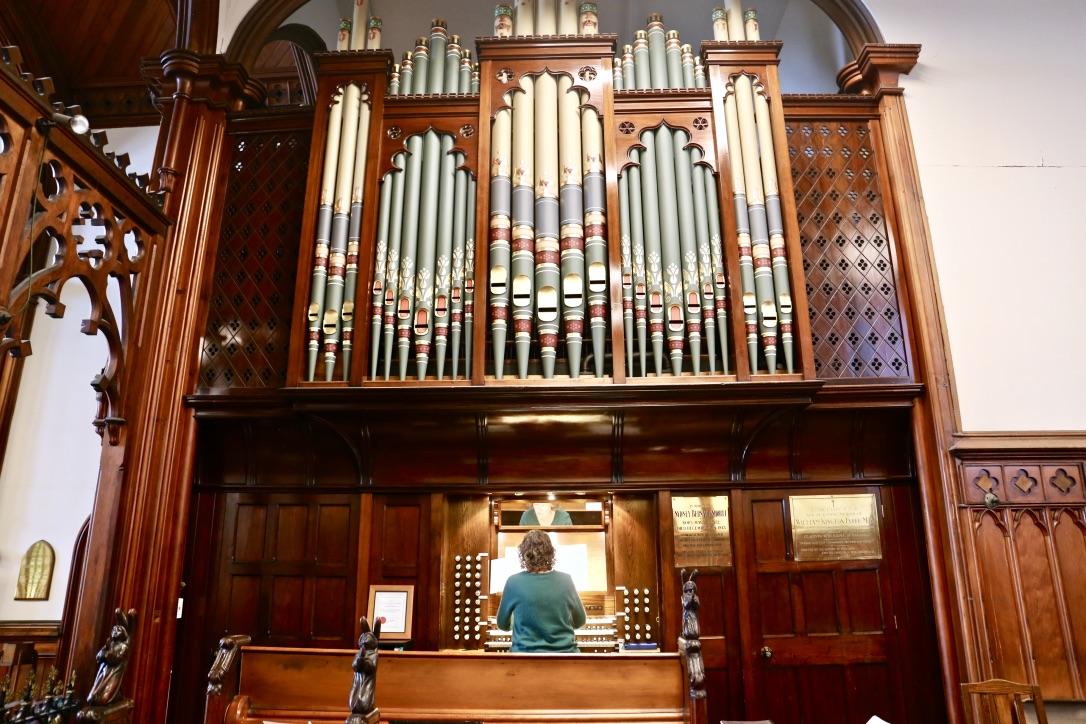 woman sits at organ