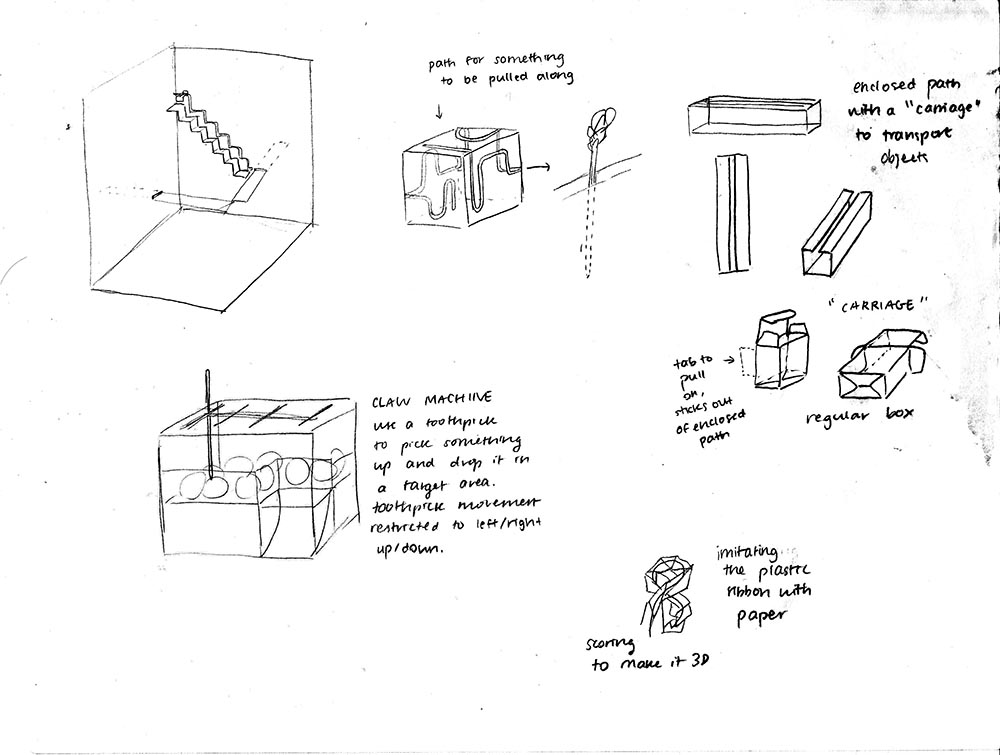 Sketches of paper structures that are meant to show up and down movement. The first shows a paper staircase against a paper wall. The other sketches show paper cubes with thin pathways cut out of them, which act like pathways for a toothpick when inserted.