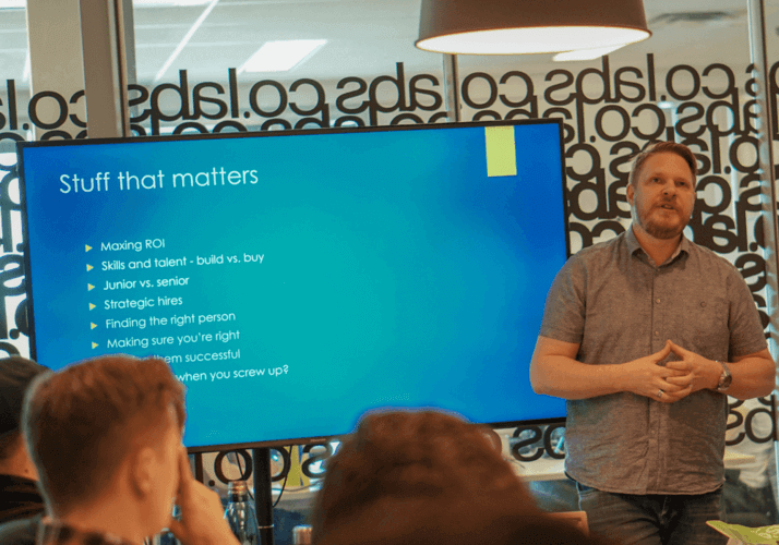 Man giving a presentation via Smartboard screen.
