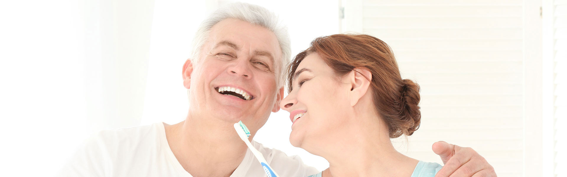 Couple smiling with toothbrush