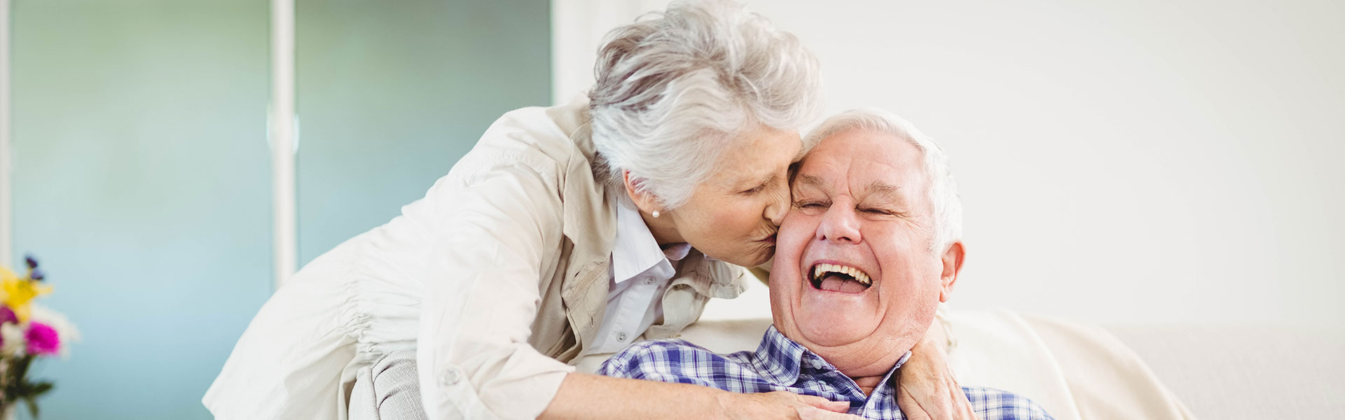 Happy older couple with healthy teeth