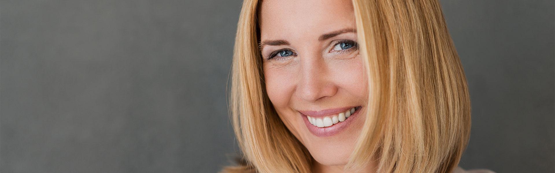 Woman smiling a confident smile