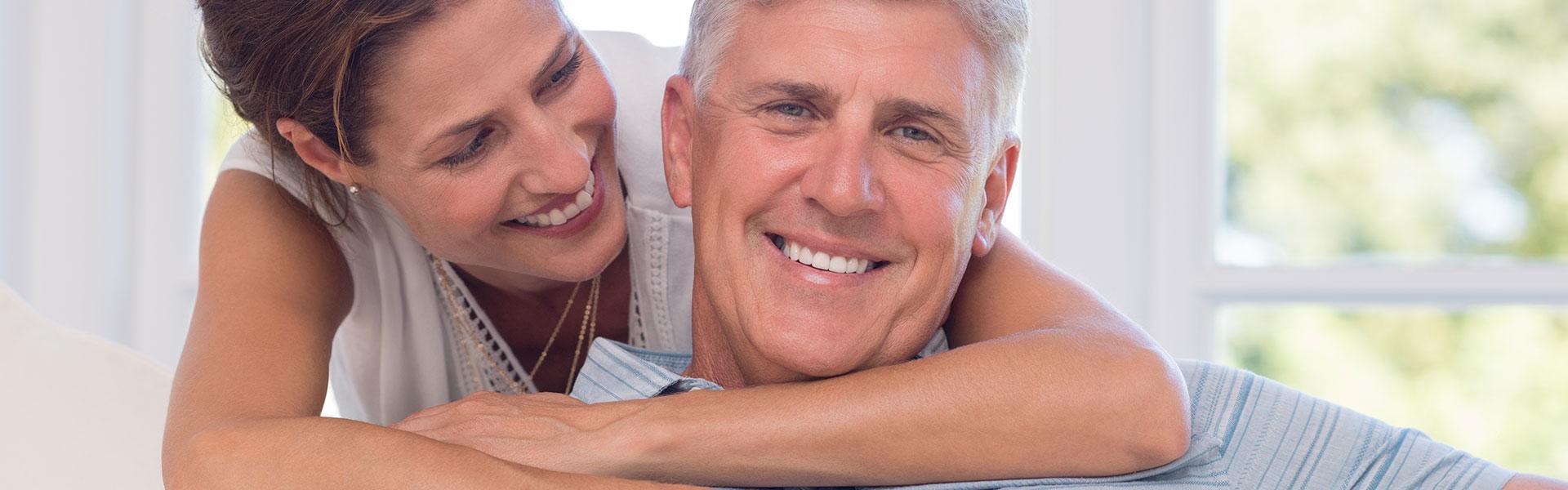 Happy couple with beautiful teeth
