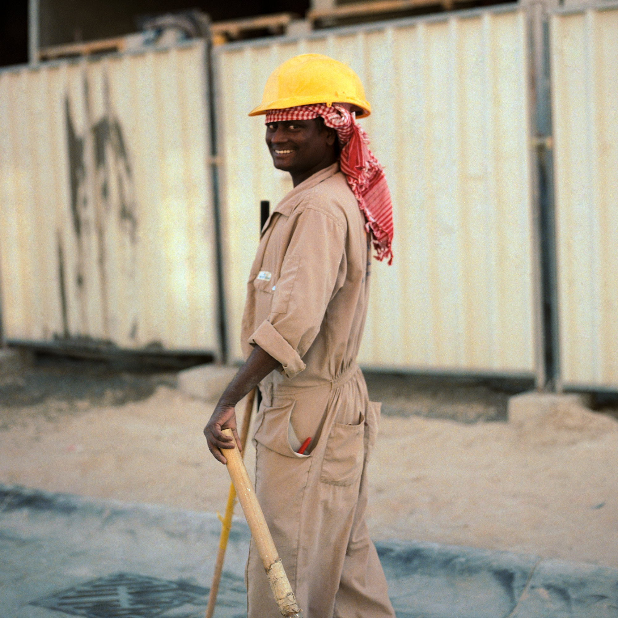 Indian construction worker on worksite. Dubai Labourers.
