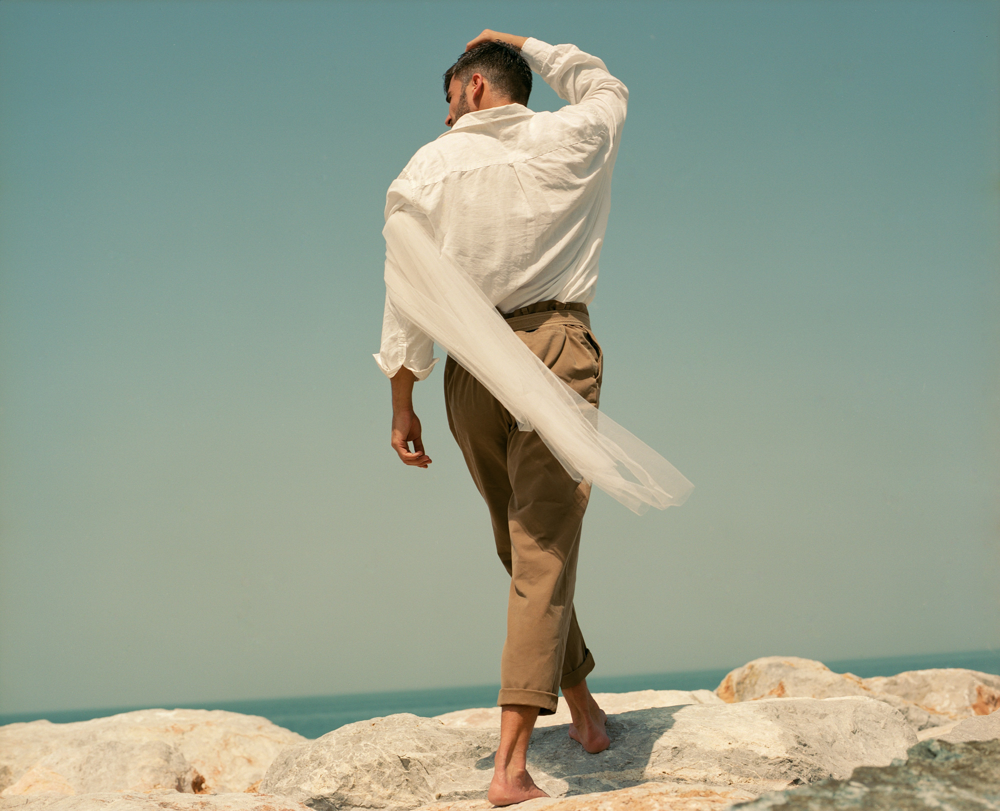 Slavko Moljac in the sea Dubai. In The Odyssey Of Mr Crusoe feature for Lewis Magazine, Photography By Ioannis Koussertari