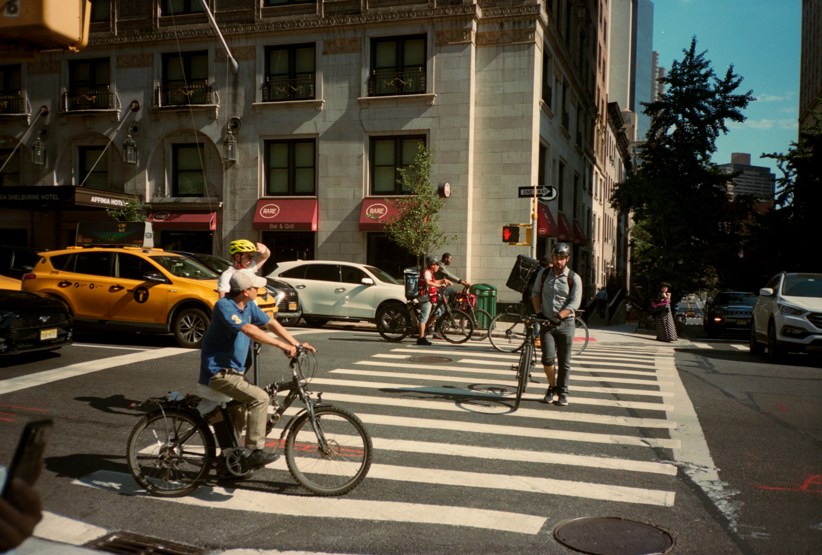 Crossing coming traffic, Upper East Side, New York. Lonely New York Series. Photography By Ioannis Koussertari.