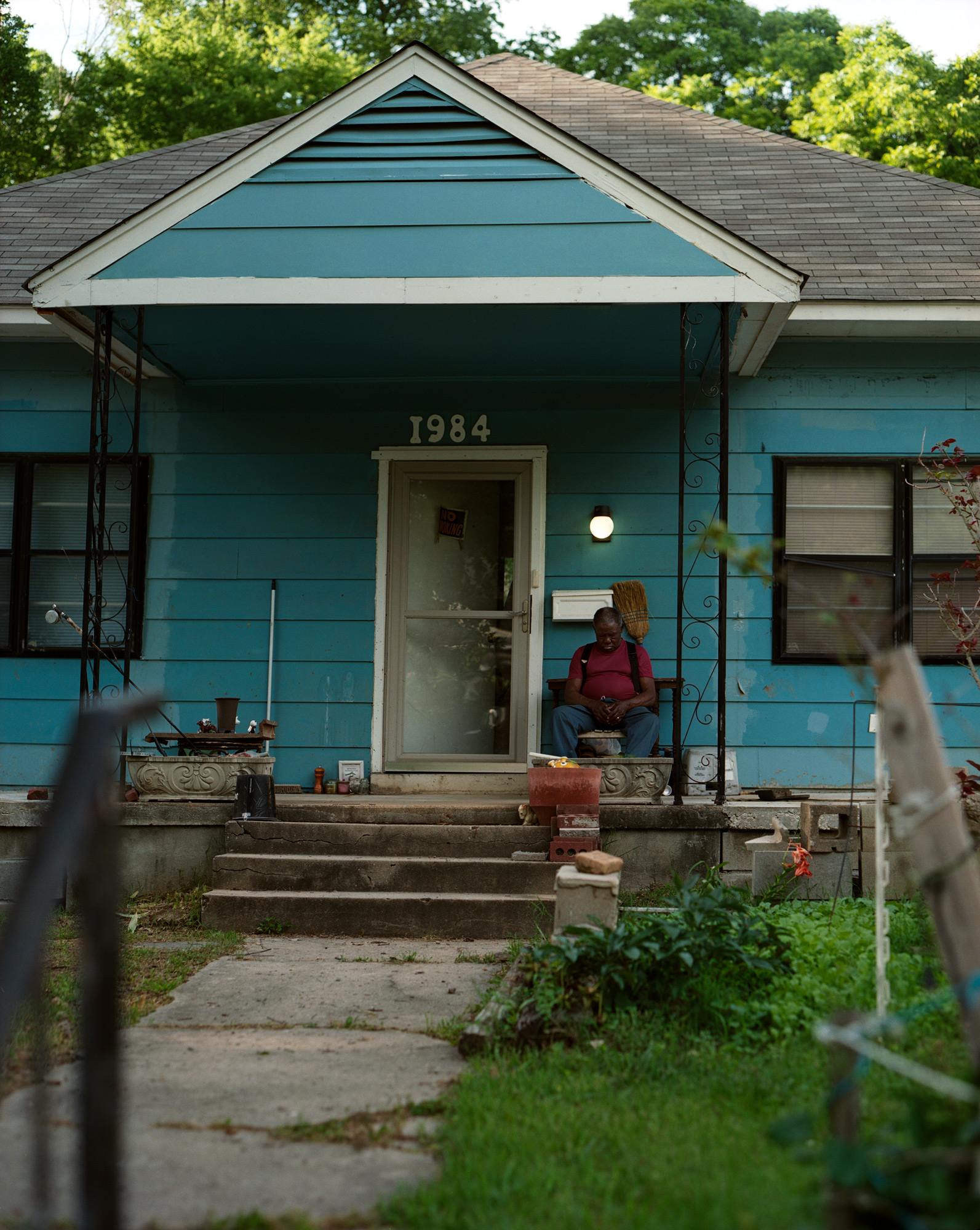 Man asleep on his front porch. New Orleans, Omg Your English, Photography By Ioannis Koussertari