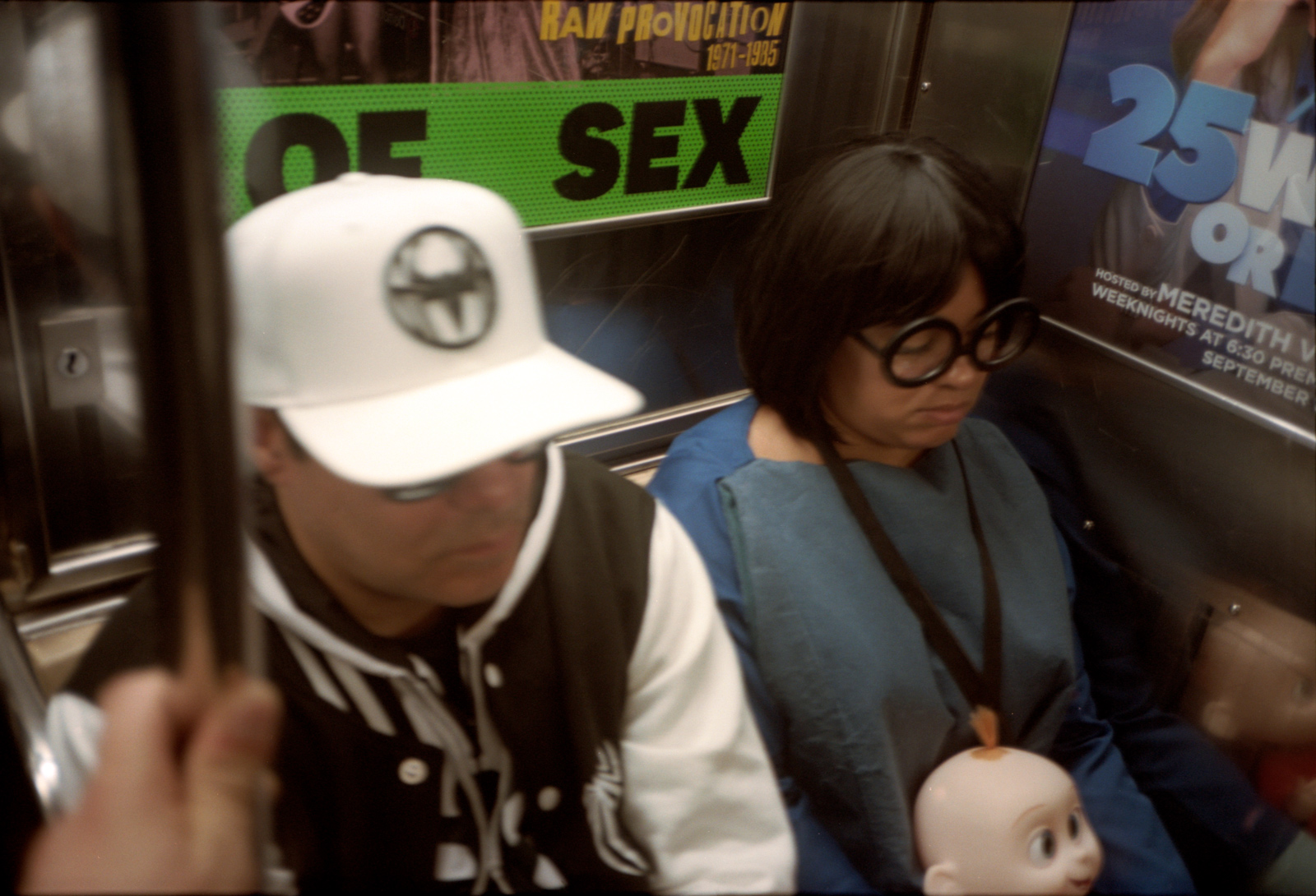 Asleep on the New York Subway, Lonely New York Photography Ioannis Koussertari.