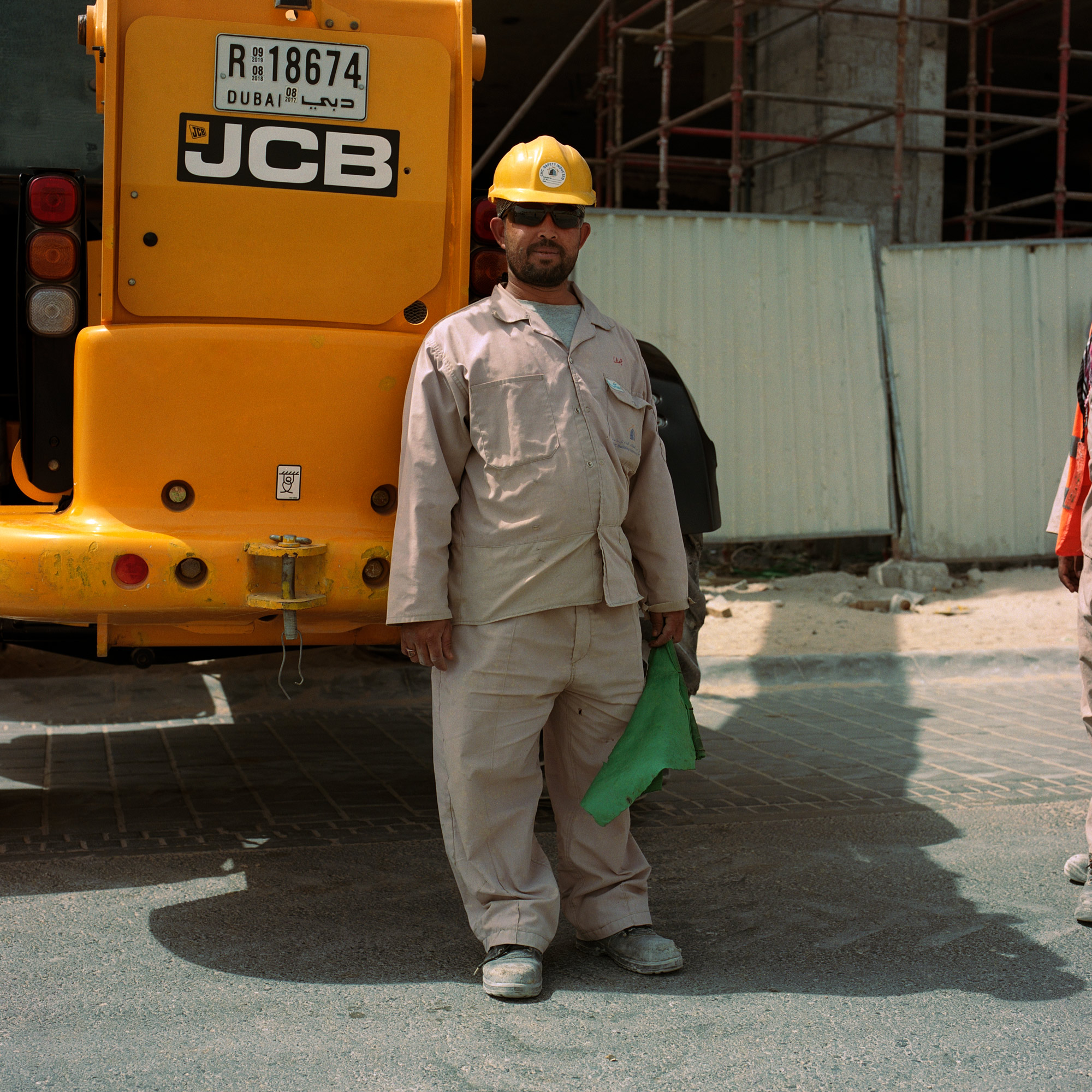 Indian construction worker in hard hat on site in Dubai. Dubai Labourers.