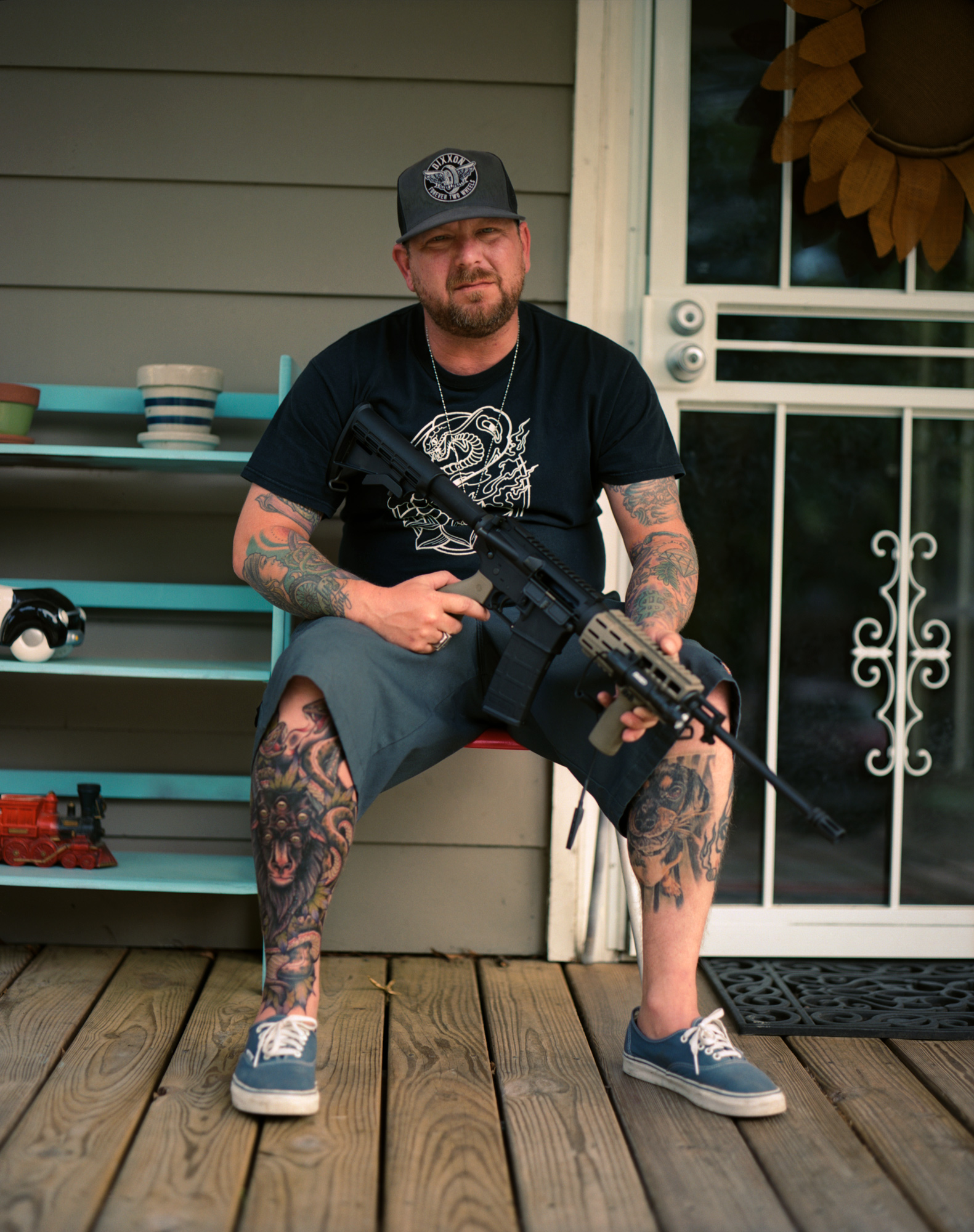 Derek with an AK47 Gun on Front Porch in Memphis, OMG your English Series