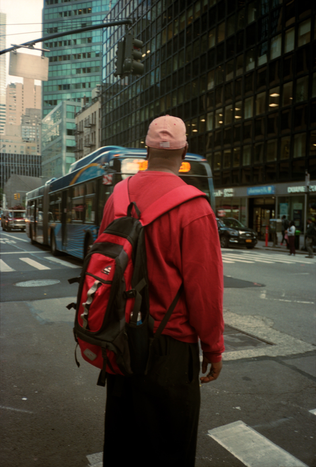 Varsity Player on the streets in New York. Lonely New York Photography Ioannis Koussertari.
