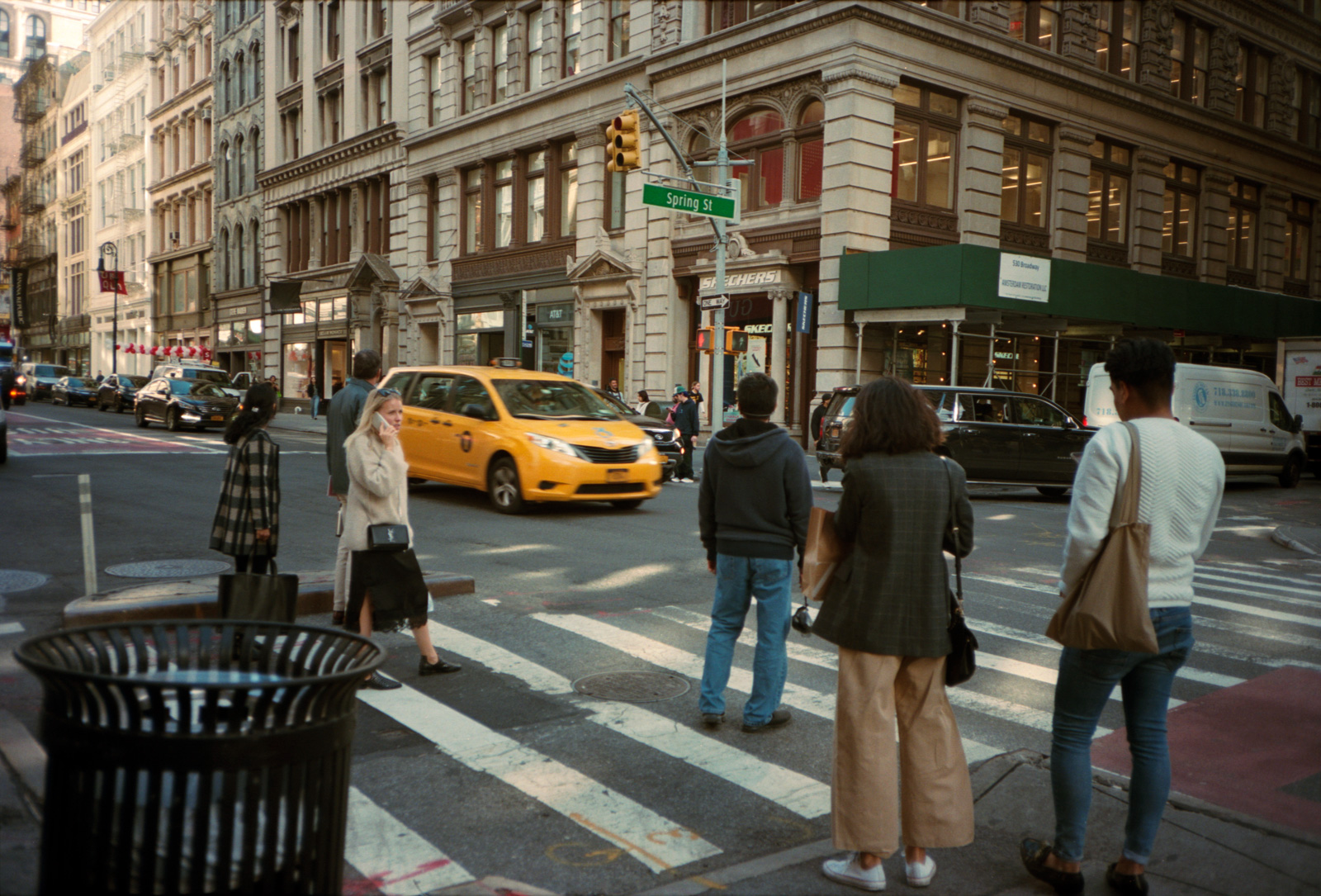 people at Spring Street downtown. Lonely New York Series. Photography By Ioannis Koussertari.