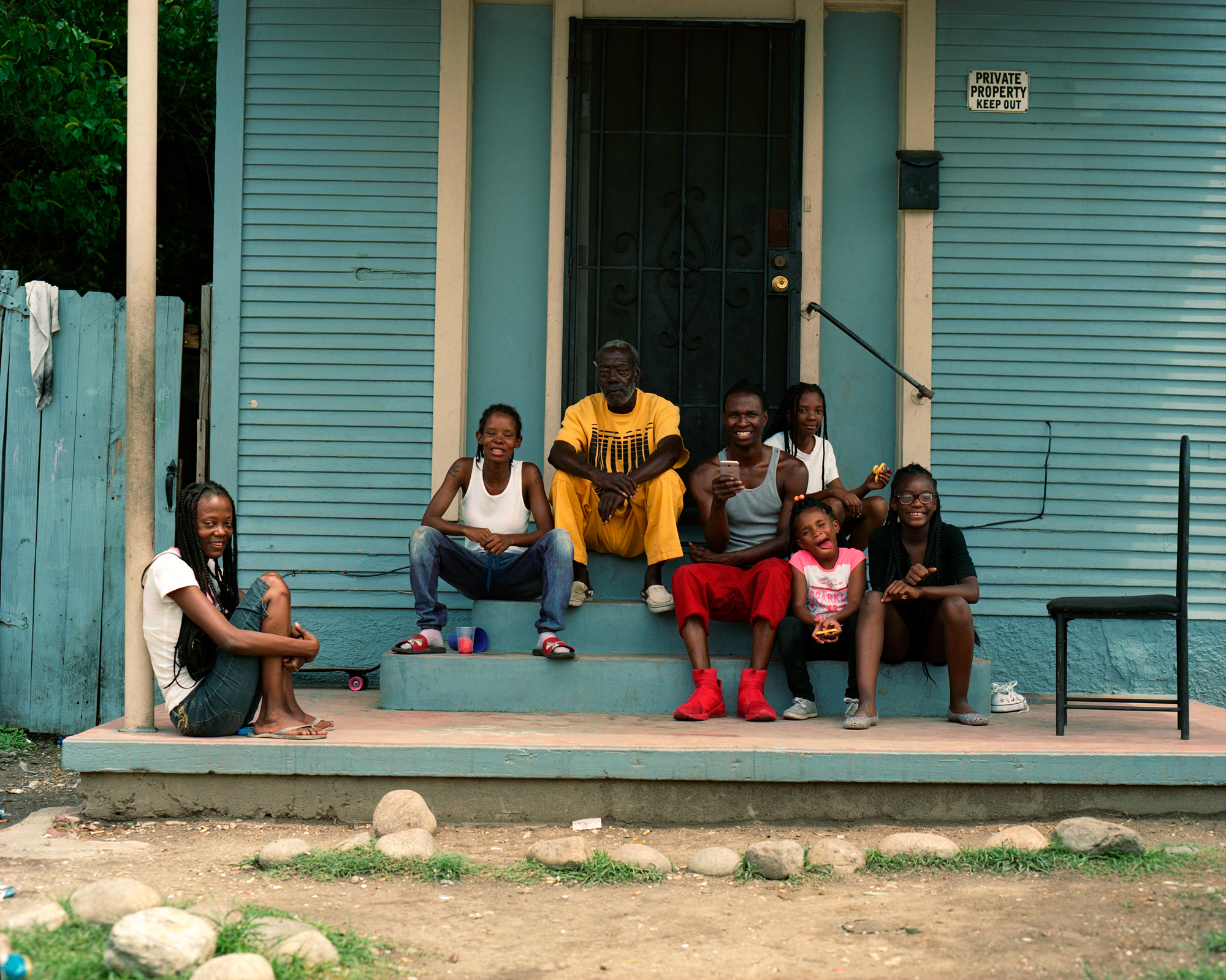 Family Sitting On Front Porch, Private Property, New-Orleans, Omg Your English, Photography By Ioannis Koussertari