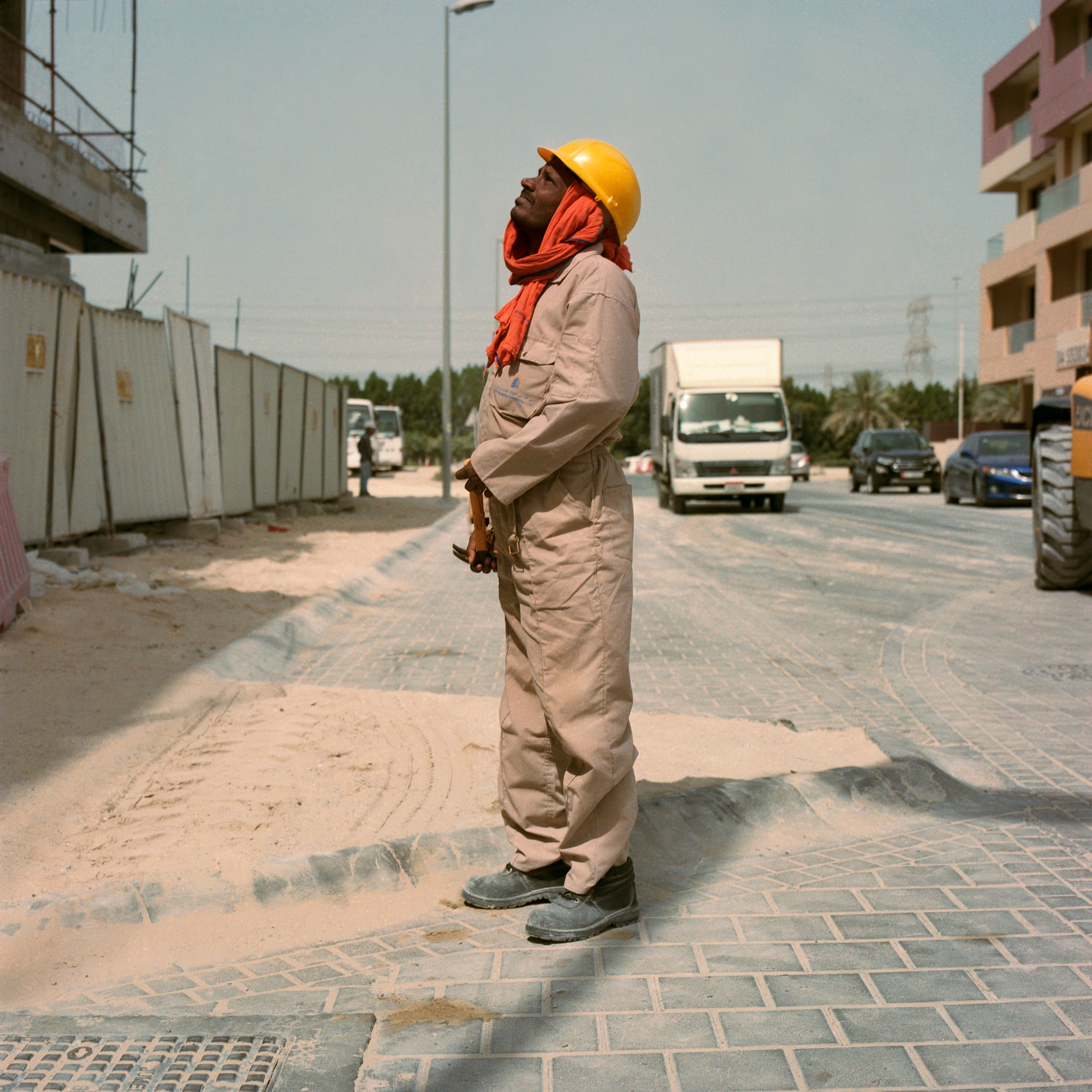 Indian construction worker in hard hat at work on site in Dubai. Dubai Labourers.