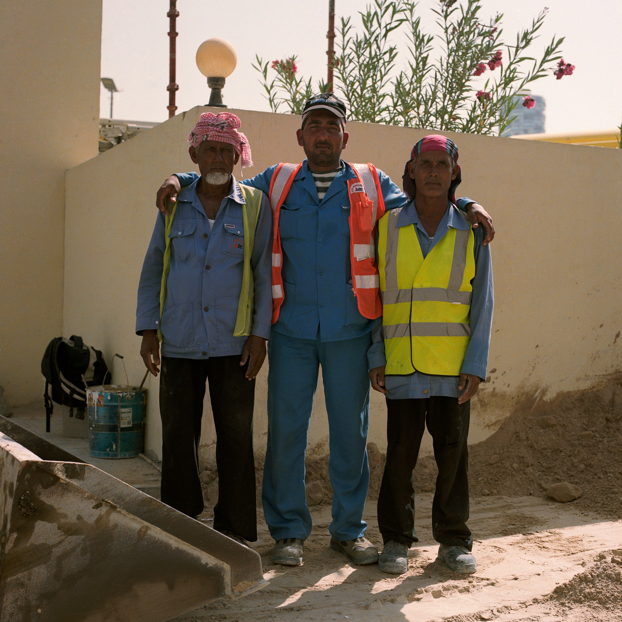 Three Indian construction workers on worksite. Dubai Labourers.