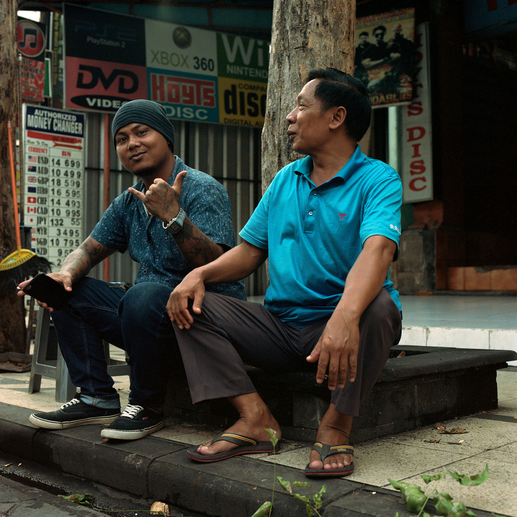 Father And Son, Street Traders, Kuta Bali, Eastern Travels, Photography by Ioannis Koussertari