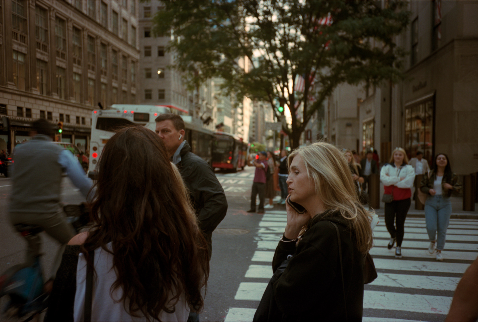 Woman on a private call on the streets of New York. Lonely New York series. Photography Ioannis Koussertari.