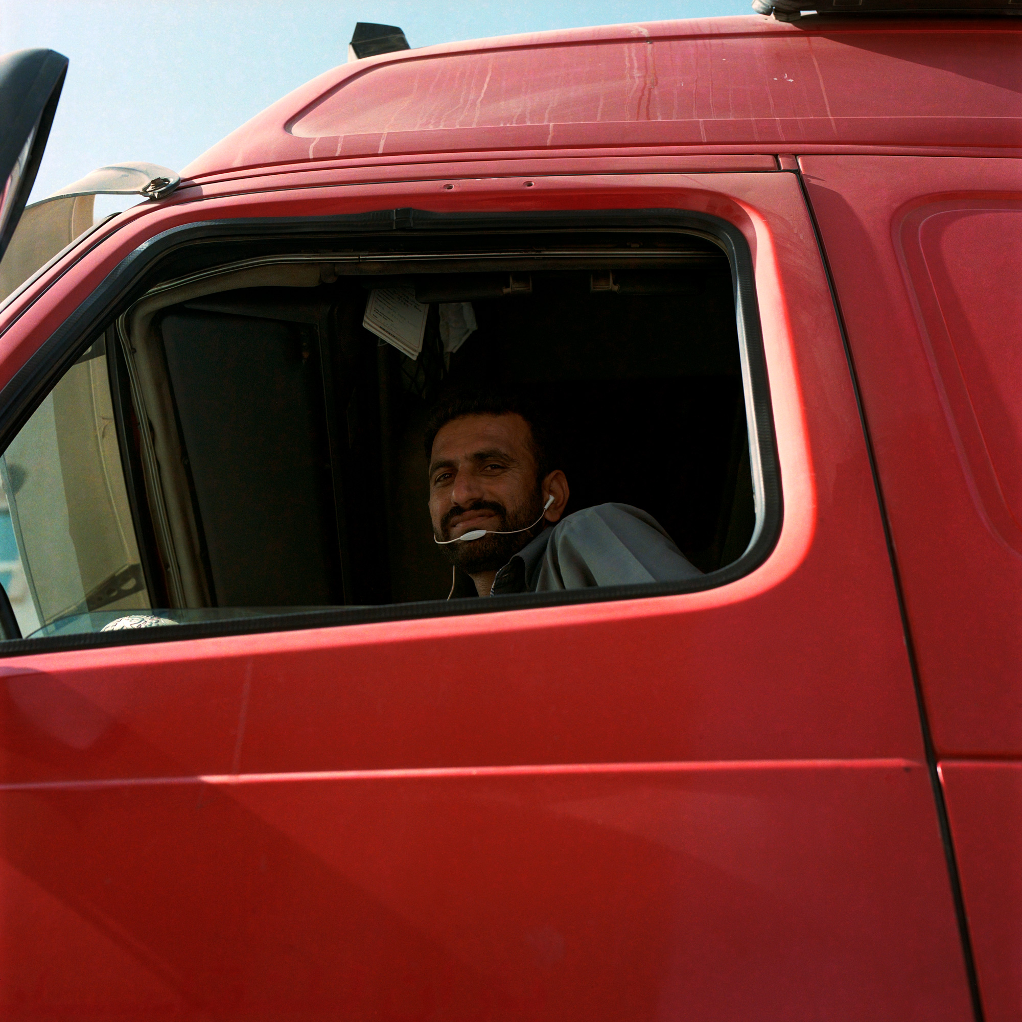 Truck driver at the wheel. construction workers on worksite, Dubai Labourers.