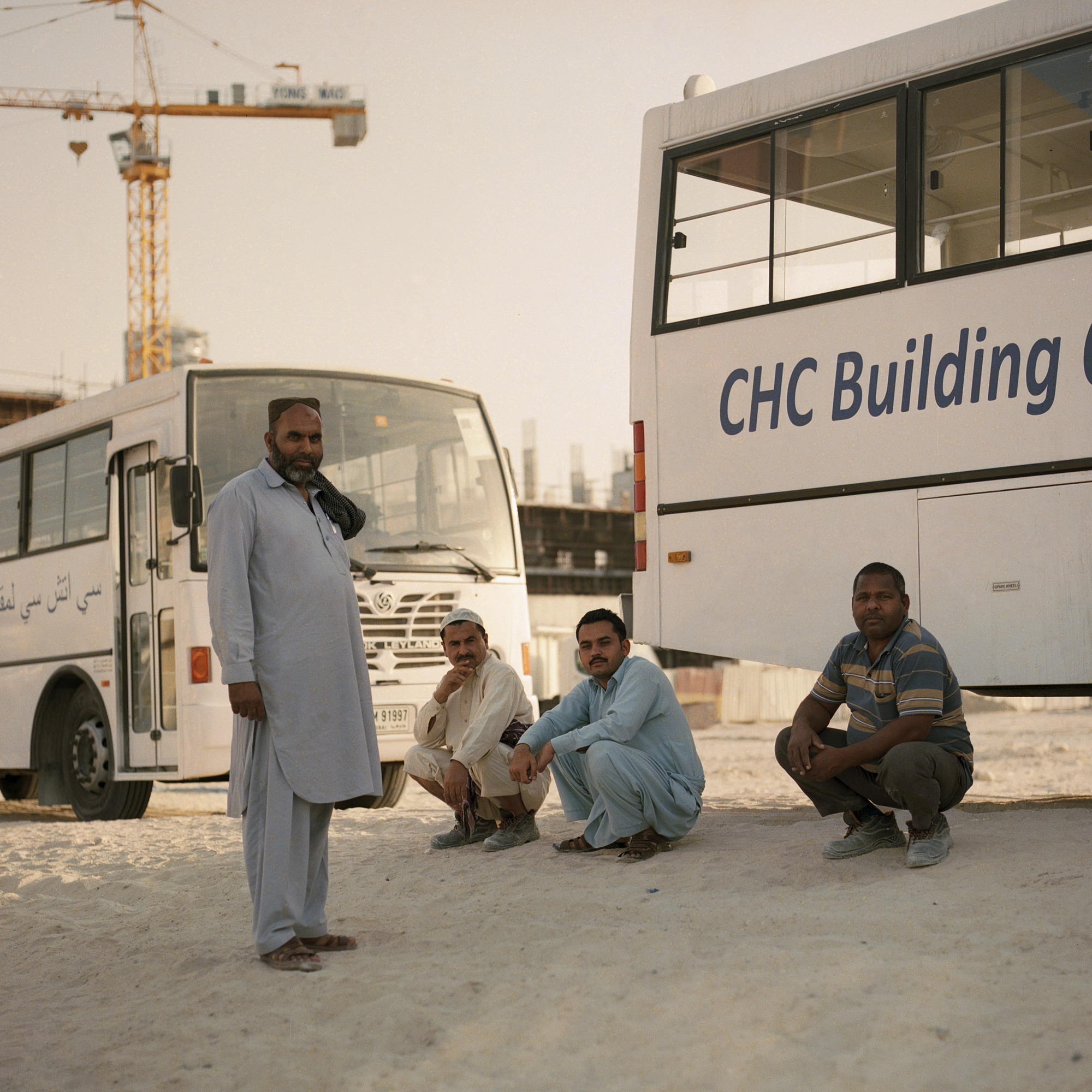 Indian construction workers end of day waiting to go home. Dubai Labourers.