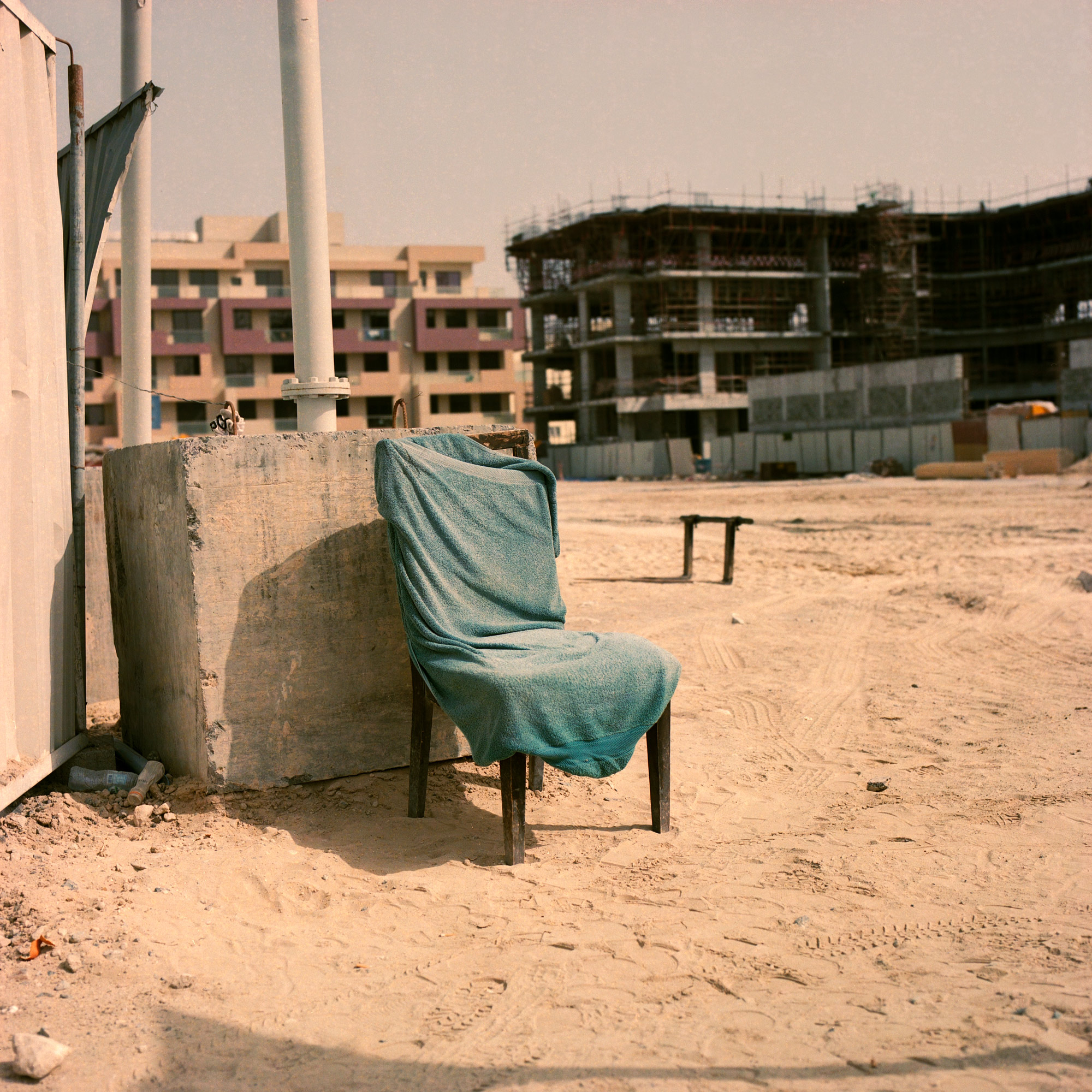 A towel covered chair on construction site in Dubai, Dubai Labourers