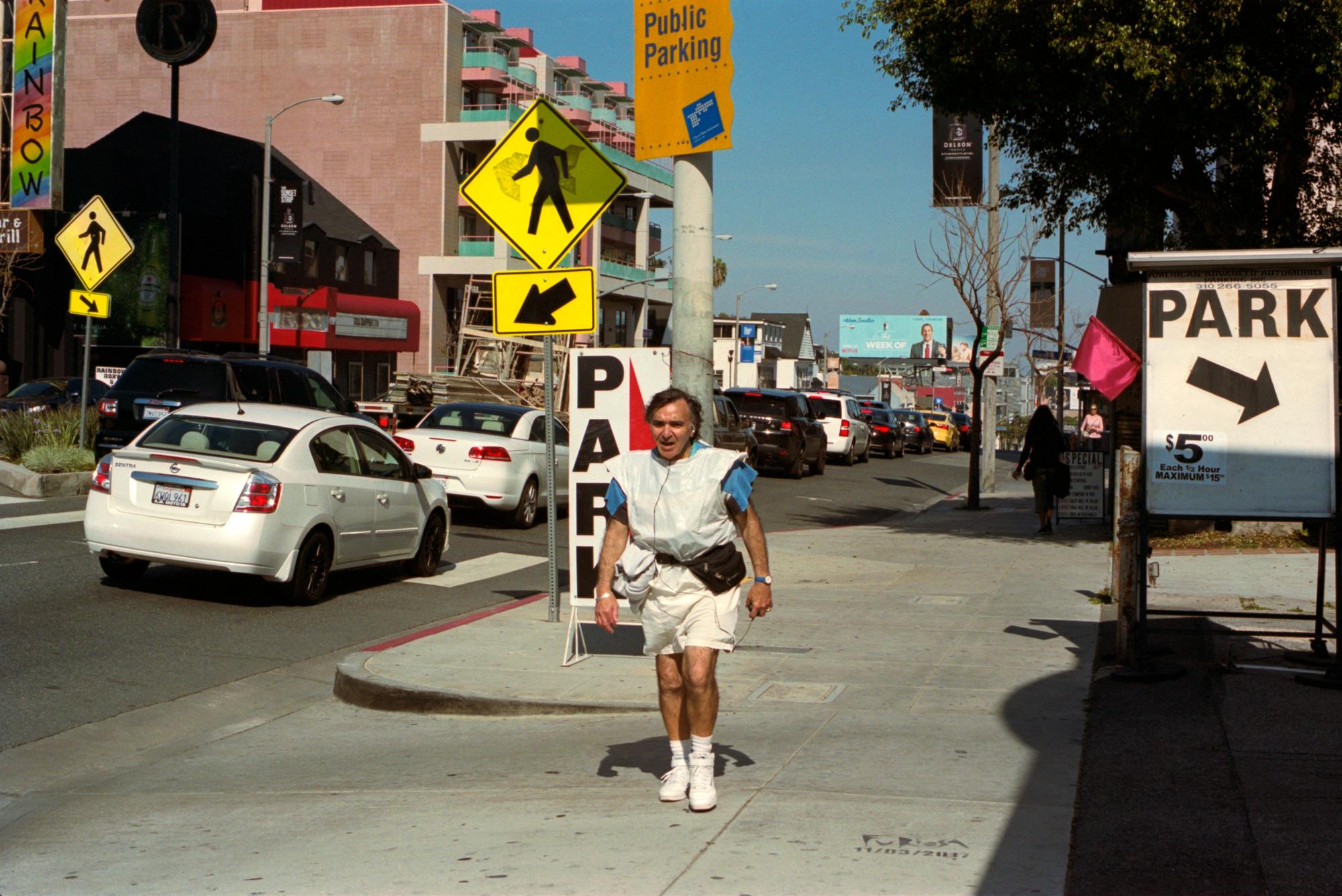 Power walking on Sunset Blvd, LA. Omy Your English, Photography By Ioannis Koussertari