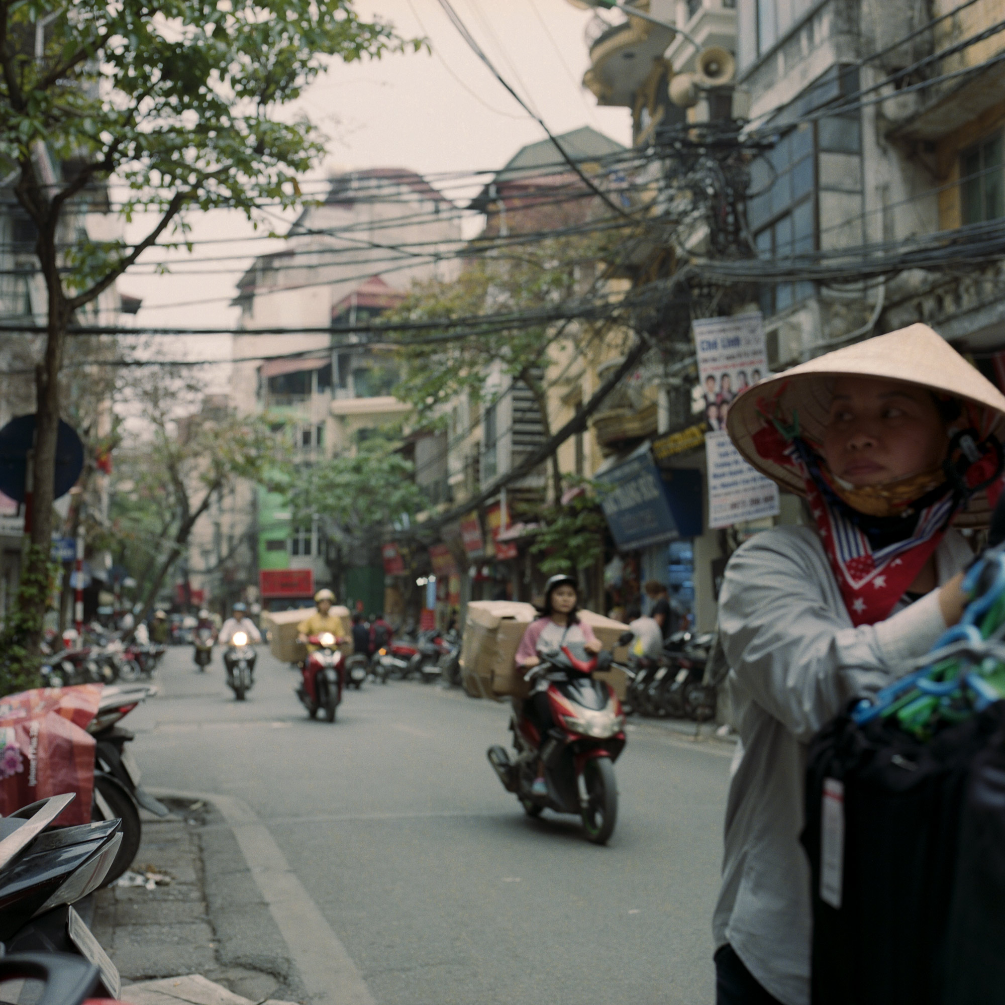 Traffic, motorcyclists, the street culture in Hanoi, Vietnam. Eastern Travels, photography By Ioannis Koussertari