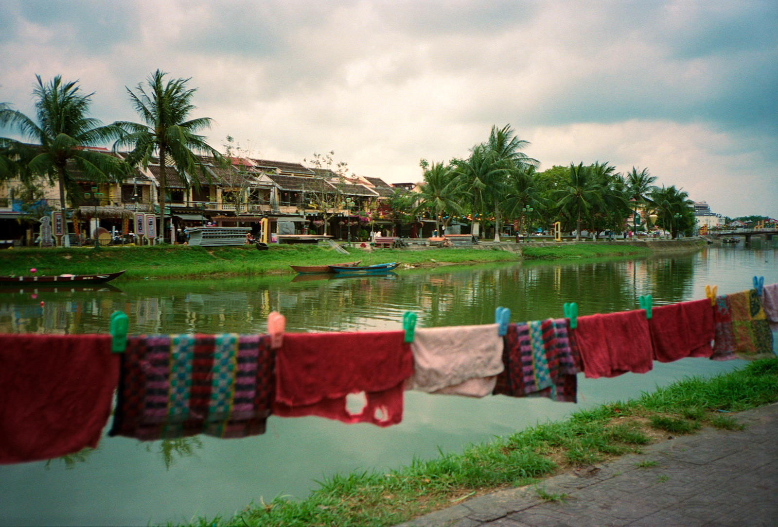 Clothing on the washing line, along the riverfront, Thu Bon River, Hoi An Vietnam,  Eastern Travels, photography by ioannis koussertari