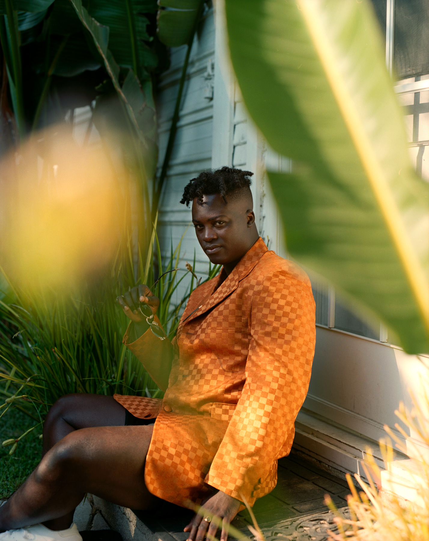 Bipolar Sunshine, singer at home in his garden in  Los Angeles 2017. Photography By Ioannis Koussertari