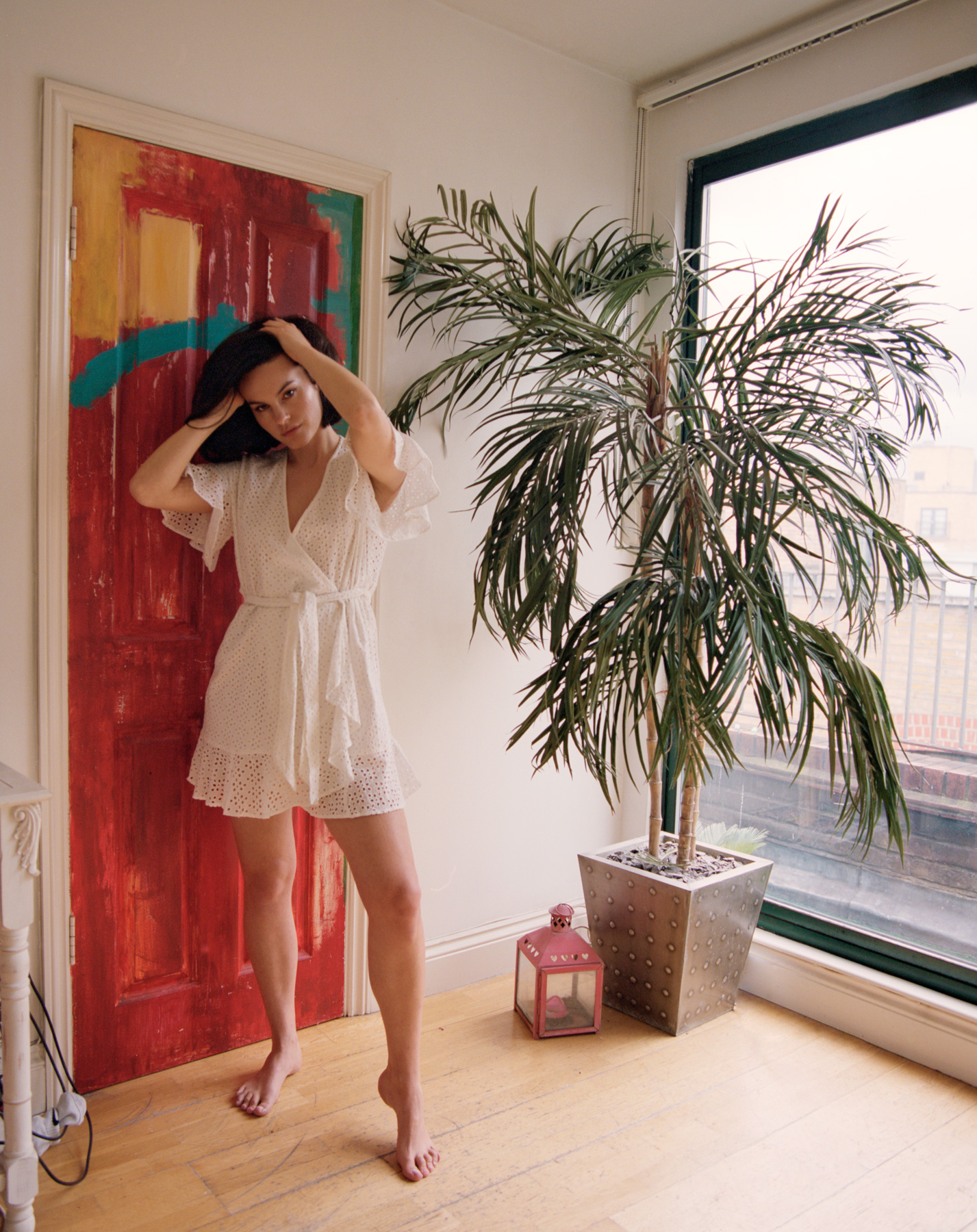 Lola Coca, modelled infront of red door at her apartment in Shoreditch, London, By ioannis Koussertari