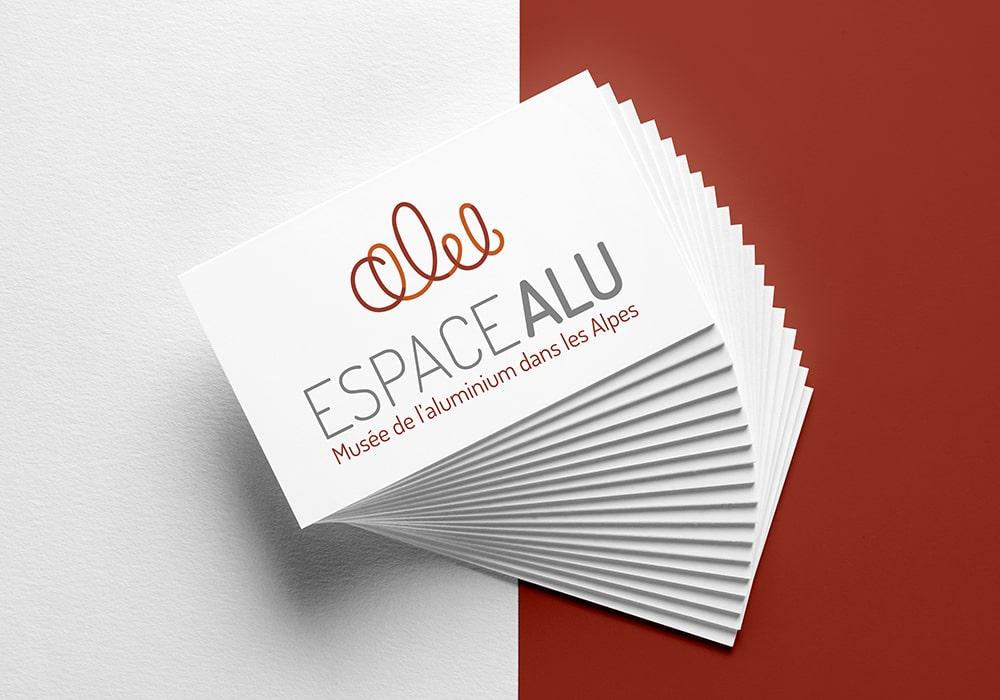 Naöms graphiste communication Albertville logo espace alu musée de l'aluminium dans les alpes