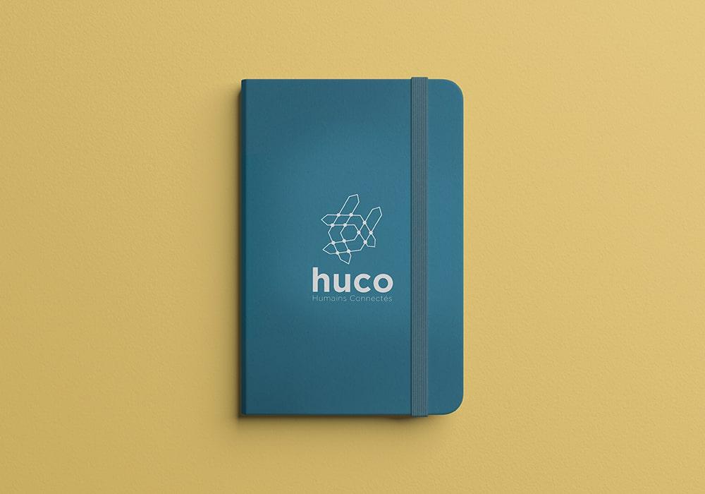 Naöms graphiste communication Albertville logo huco