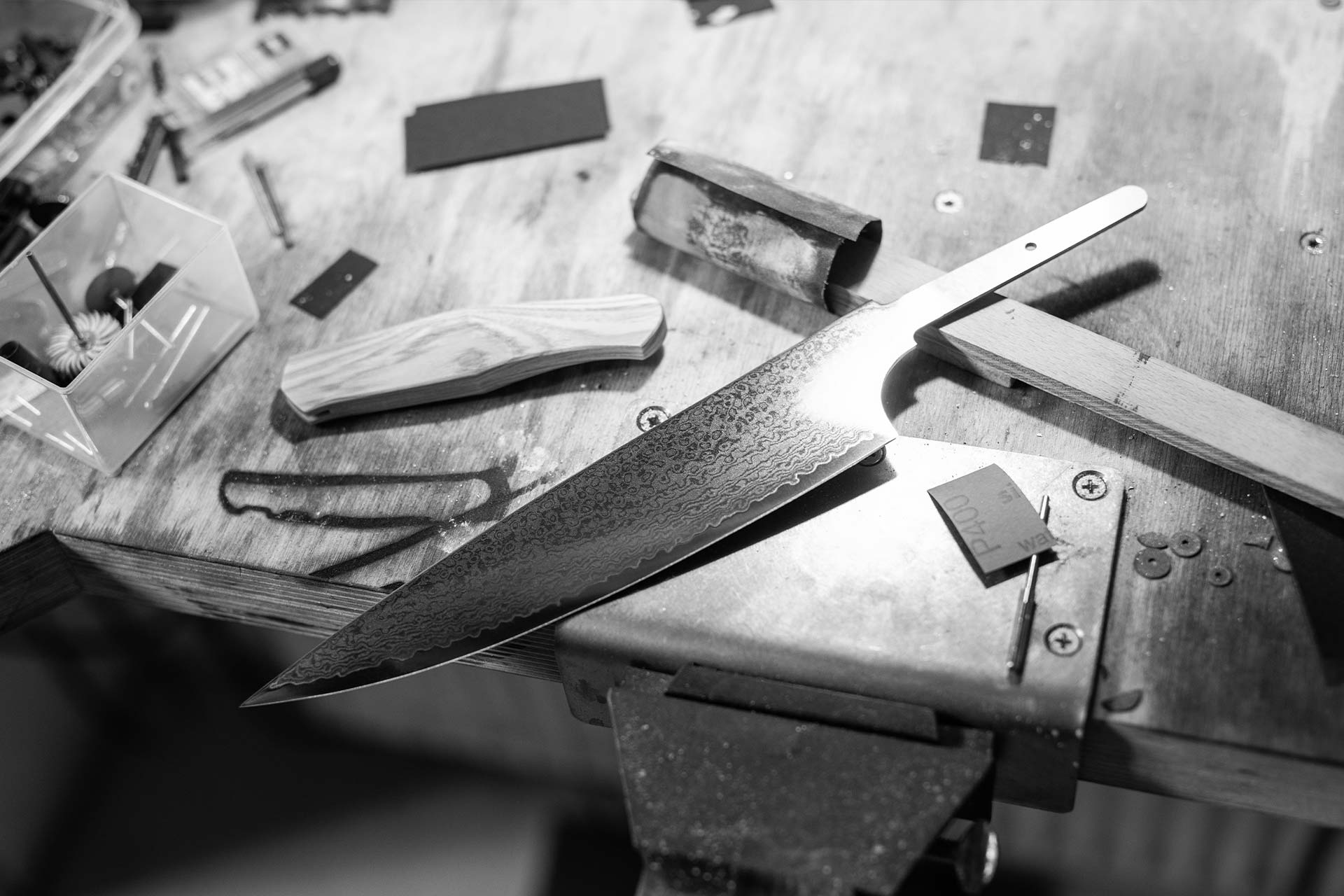 Handcrafted kitchen knife on work table