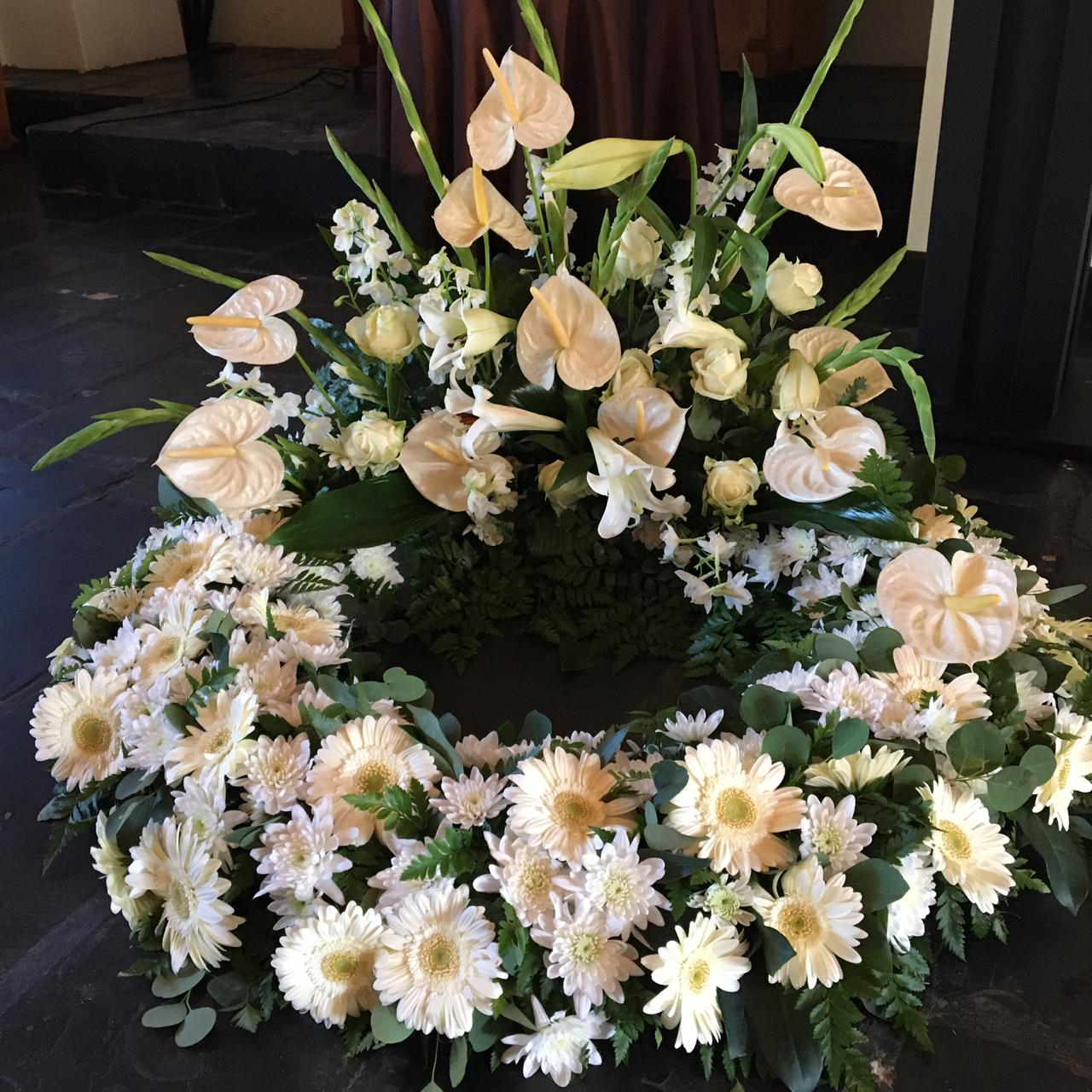 White flowers decorated in a large wreathe