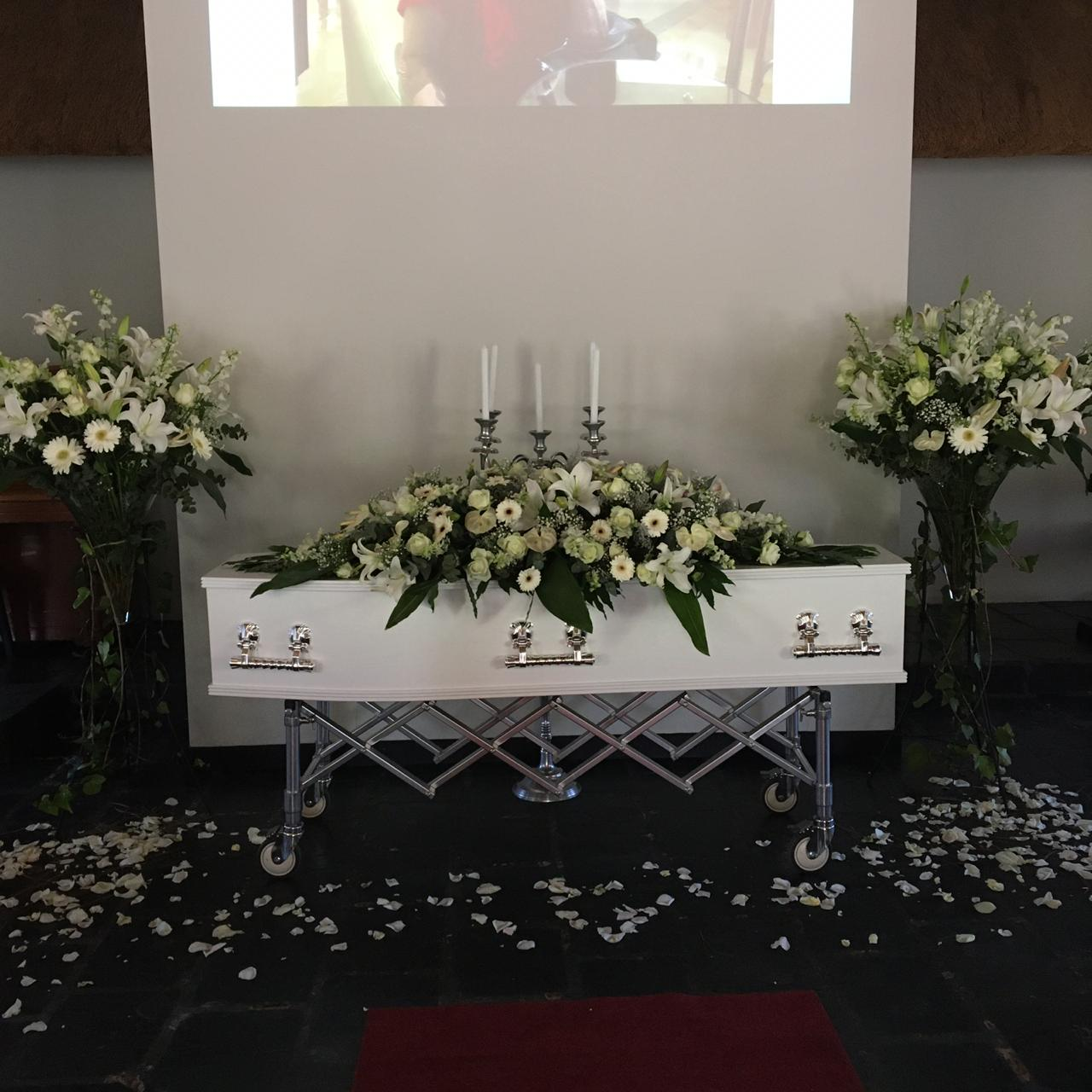 Chapel setup for a funeral with white flowers from