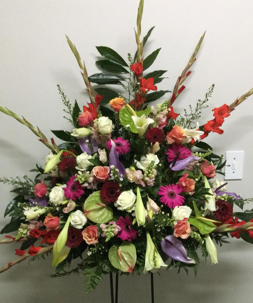 Exotic arrangement with assorted flowers and colors