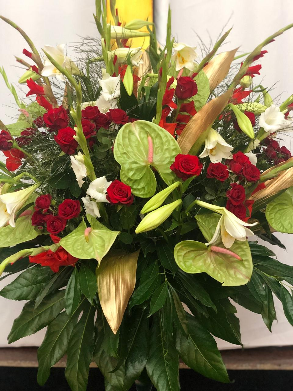 Christmas church arrangement in red green gold and white from