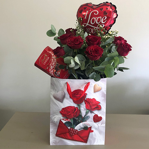 Rose Bag with red Roses and Box of Lindor Chocolates and Balloon