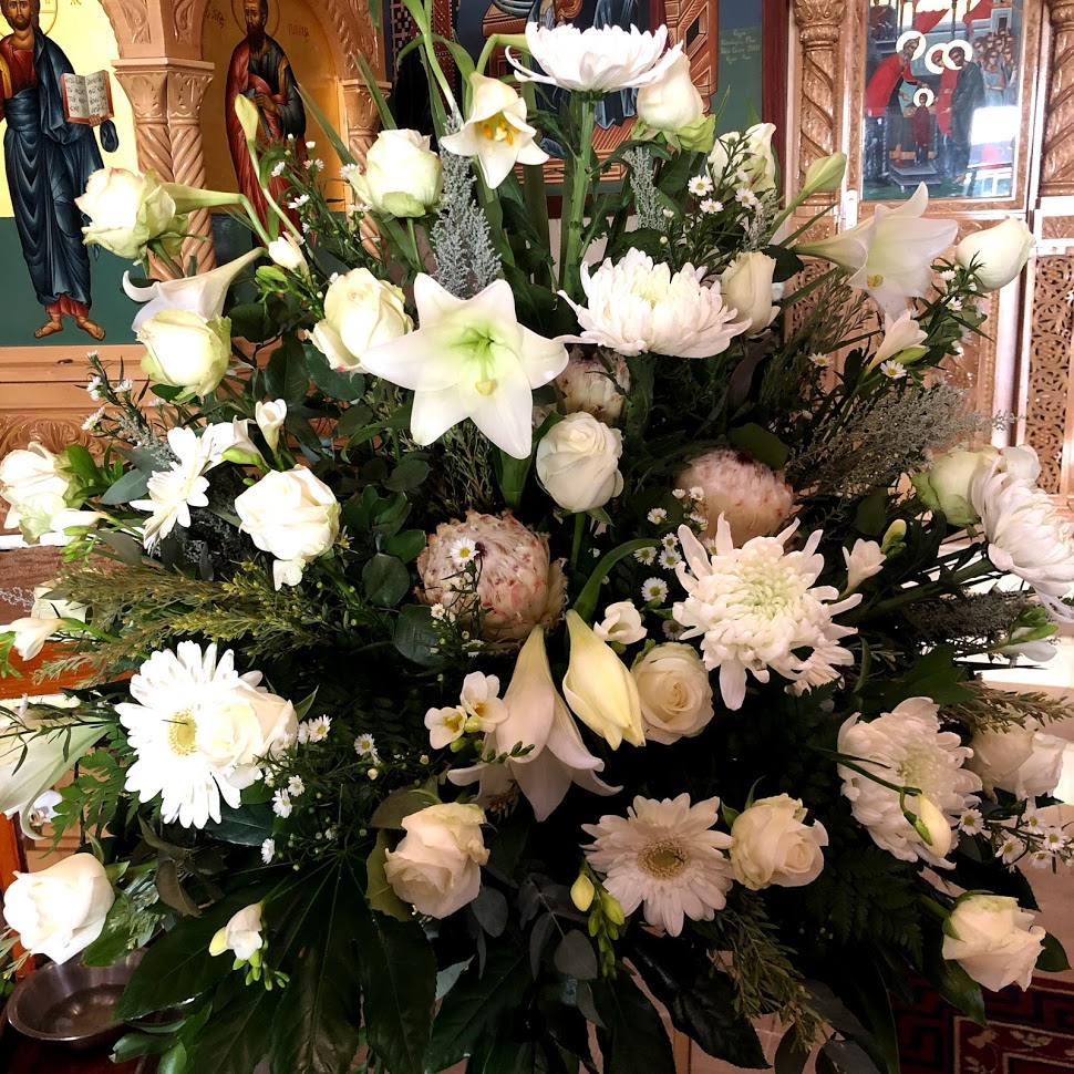 large Church Arrangement with a seasonal mix of white flowers