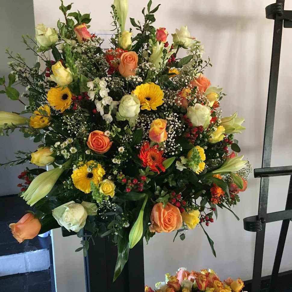 Seasonal arrangement in shades of yellows and oranges
