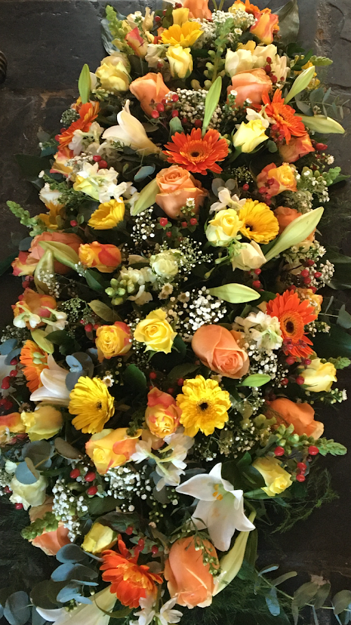 Coffin Spray with seasonal flowers in colours of the sun