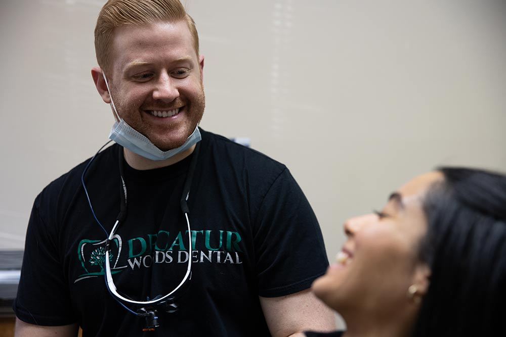 Dr. Keller smiling with a patient
