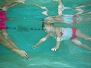 Infant and children's swim lessons with 1-on-1 instruction
