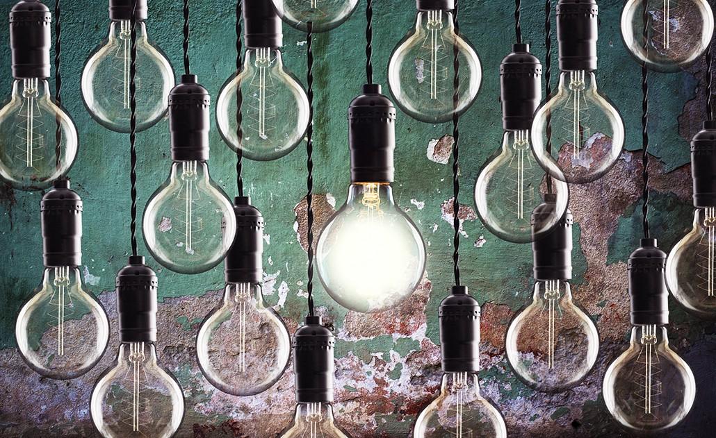An artsy array of hanging lightbulbs.