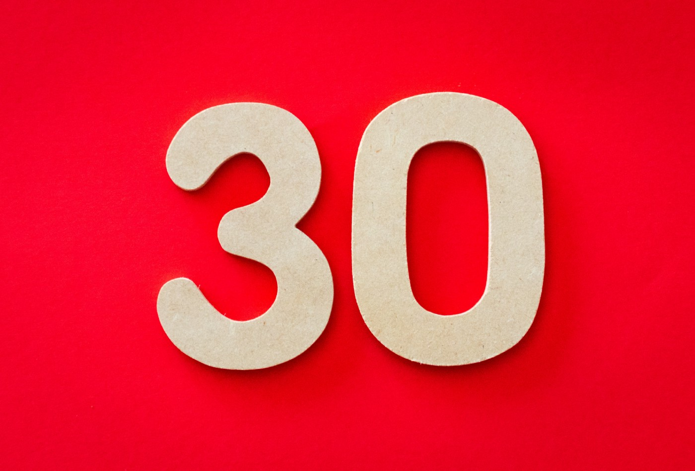 A red background with giant wood block numbers: 30.