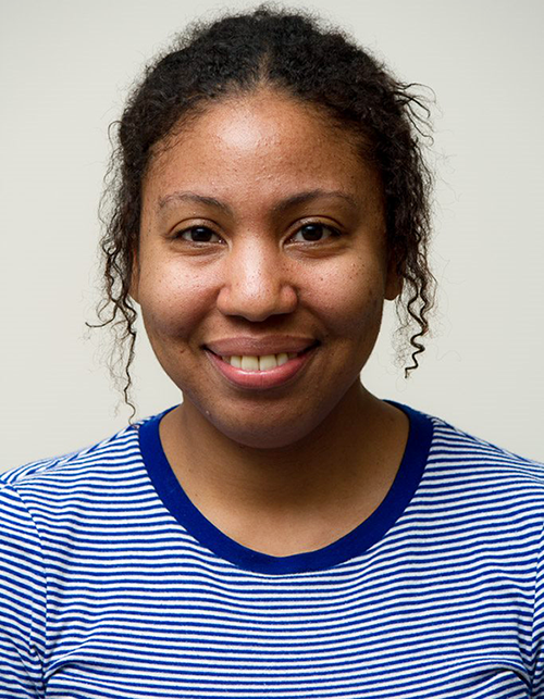 Becky Brasfield is smiling and wearing a blue and white striped t-shirt.