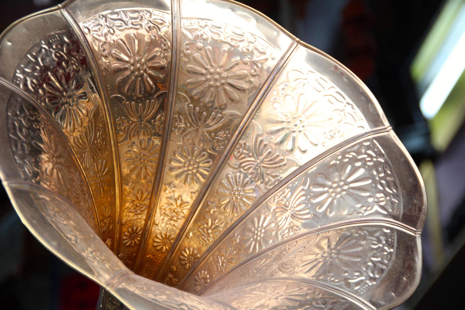 A bronze, antique gramophone.